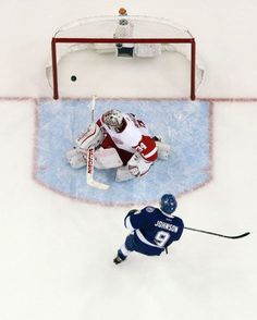 Tampa Bay Lightning center Tyler Johnson (9) scores past Detroit Red Wings goalie Petr Mrazek (34), of the Czech Republic, during the second period of Game 2 of a first-round NHL Stanley Cup hockey playoff series Saturday, April 18, 2015, in Tampa, Fla. The Lightning won the game 5-1. (AP Photo/O'Meara)