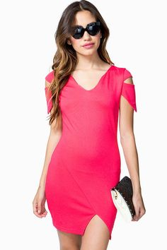 Make sure all the angles are covered! A short knit bodycon dress featuring cutout short sleeves and an asymmetrical front slit. Scoop neck. Concealed zip closure in the back. Finished hem.