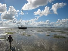Drying out on the Waddenzee, fun for the kids to walk and play in the warm water. #Stadtship 56 by KM Yachtbuilders