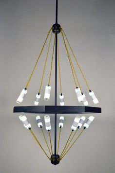 Esta lámpara utiliza imanes para mantener las luces en su lugar - http://www.decoracion2014.com/ideas-de-decoracion/esta-lampara-utiliza-imanes-para-mantener-las-luces-en-su-lugar/