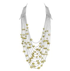 Mikimoto Gold Cascade necklace featuring gold pearls and diamonds in white gold.