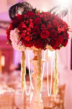 epic wedding in Los Angeles California weddings red rose with feathers pearls centerpiece and Reception, Hollywood Glam, Centerpieces, Red Wedding Centerpieces, Pearl Centerpiece, Feather Centerpieces, Candle Centerpieces, Centrepieces, Centerpiece Ideas, Red Rose Wedding, Wedding Flowers, Ruby Wedding