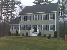 color of my house.. it's going to look like a clown house. Vinyl siding Cypress green  http://www.mbmcarpentry.com/siding/