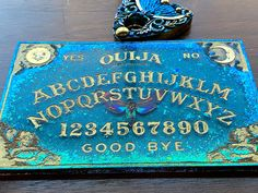 Excited to share this item from my shop: Teal and Gold Ouija Board tray with planchette #ouija #goldfoiled #etsy Beautiful Symbols, Cat Skull, Diy Resin Art, Copper Frame, Resin Casting, Teal And Gold, Ouija, Gold Paint, Teal Colors