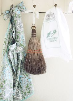 A vintage Apron, A vintage Sweep and a tea towel with a hand embroidered Ball Jar on it!
