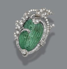 CARVED EMERALD AND DIAMOND PENDANT-BROOCH, CIRCA 1935. | © 2015 Sotheby's