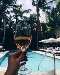 Abigail with her first glass of wine by the pool. The drinking age for the Bahamas is 18 and their family vacation fell on her birthday. Cheers!