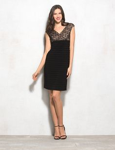 Does it get any better than the LBD? Add lace and a super-flattering silhouette (the shutter tiers work wonders for your figure), and we say yes. Black lace bodice with neutral lining. Surplice V-neck; V-back. Shutter tiers on front and back of skirt. db Signature exclusively for DRESSBAR. Imported.
