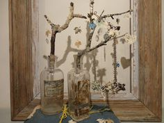 branches in bottles to display jewelry