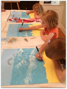 1st grade: (May Project) torn paper for beach, painted water on blue construction paper.