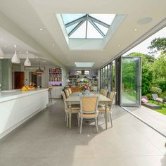 The open plan layout of this kitchen is the perfect room to socialise in, the bi fold doors extend the space into the garden and the roof light makes the room so much brighter! Open Plan Kitchen Dining Living, Open Plan Kitchen Diner, Open Plan Living, Living Room Kitchen, Home Decor Kitchen, Kitchen Ideas, Kitchen Layout, Kitchen Inspiration, Dining Room