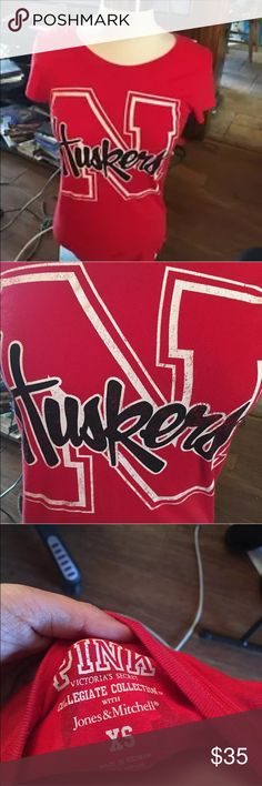 Pink by VS Husker Alumni Collegiate Tee XS This is a crew neck graphic tee by Pink by Victoria's Secret.  It is red and has the Nebraska Huskers logo on the front and says Pink <3 Husker Alumni in the back.  The faded print was how it was made.  It is still in great condition in an XS. PINK Victoria's Secret Tops Tees - Short Sleeve