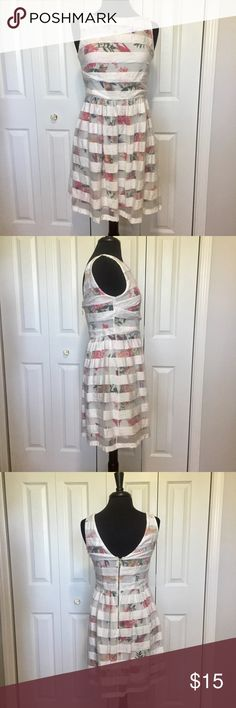 Promod sleeveless floral dress with white overlay This dress is in good condition with no stains or rips.  A Brand of clothing from Europe. Please look at tag photos. Has a zip back. Measurements taken flat and in inches. Armpit to armpit 17. Shoulder to waist 15. Waist 15. Waist to hem 19 Promod Dresses Mini