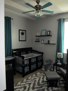 Grey chevron and teal or turquoise boys' nursery or room with black furniture. Painted