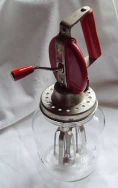 Vintage German Glass Butter Churn Cream Whisk Quick Red Handle Kitchenalia. €40.00, via Etsy.