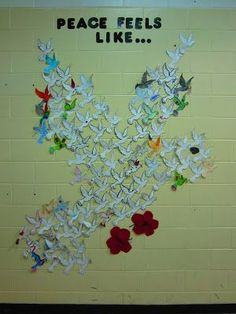 Lest We Forget. Remembrance Day: What does peace feel, look, sound, smell like... each student in the school fills out a dove.