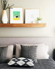 Shelving above bed with neutral headboard.