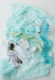 This lovely mint green hand dyed fabric styling bundle, which is perfect for wedding table decoration and photo shoot styling, comes with:  - mint cotton gauze runner of 70 cm / 28 inches wide and 2,6 m / 2,8 yards in length - light gray heavy silk crepe napkin of 23 cm / 9 inches