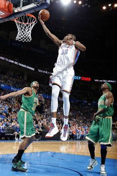 Oklahoma City's Kevin Durant (35) shoots a lay up in between Boston's Paul Pierce (34) and  Boston's Jason Terry (4) during thee NBA game between the Oklahoma City Thunder and the Boston Celtics