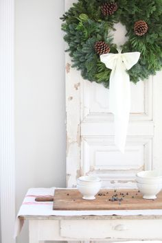 The pictures on this blog have me hooked.  Not only did I find a lovely winter wreath idea for after Christmas, there are beautiful photos of vintage love decorating.