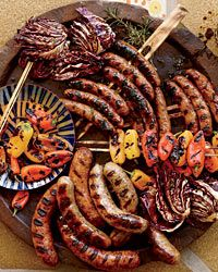 Sausage Mixed Grill - not only a GREAT photo (whose food comes out looking like that? Bet it was nasty and cold - lol) But a good tip for cooking sausages on the grill: spear them with a pair of skewers to facilitate flipping them evenly. Smart!