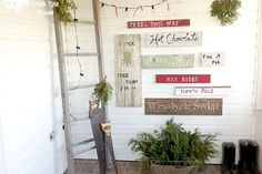 a tree farm inspired sign wall in the mudroom, christmas decorations, laundry rooms, painting, seasonal holiday d cor