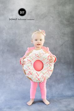 Make this DIY costume for Halloween using a cushion, fabric paint and decorative straws for a super cute donut costume for your kids. Sibling Halloween Costumes, Sibling Costume, Halloween Diy, Costume Halloween, Halloween 2018, Halloween Donuts, Newborn Halloween, Halloween College, Halloween Inspo