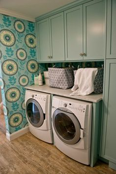 The newly renovated laundry room is properly accessorizes for looks and function. These HomeGoods laundry bins and pretty soaps finish the space. #sponsored