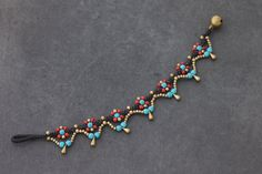 & % HAND WOVEN IN THAILAND This is hand woven bracelet made with dark brown cotton waxed cord weaved together with blue, red seed beads and brass beads. Closure using brass bell & bracelet measures inch long & available in anklet and necklace & Beaded Bracelet Patterns, Macrame Bracelets, Ankle Bracelets, Bracelet Designs, Bracelet Making, Jewelry Making, Jewelry Crafts, Handmade Jewelry, Beaded Anklets