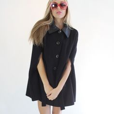 Rachel Zoe Jeni Tie Front Cape This beautiful black cape with tie detail in center front is by Rachel Zoe. Black leather detail on collar and pockets. Slits for arms to go through. Wool blend with black leather accents. Fits small or medium Rachel Zoe Jackets & Coats Capes