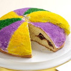 Festive King's Cake Recipe -In New Orleans, after the cake is baked a tiny toy baby is often inserted into it. Whoever gets the piece with the baby is supposed to have a year of good luck. The catch is they must also throw a Mardi Gras party next year. — Stacey West-Feather, Jay, Oklahoma