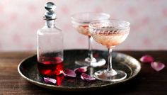 Try Sophie Dahl's delicate and fragrant take on a champagne cocktail – perfect for special occasions or just because Ingredients 1 bottle prosecco tbsp rose syrup (available from specialist suppliers) Rose Cocktail, Champagne Cocktail, Cocktail List, Rose Champagne, Champagne Glasses, Sparkling Wine, Cocktails To Make At Home, Dahl Recipe, Coffee And Walnut Cake