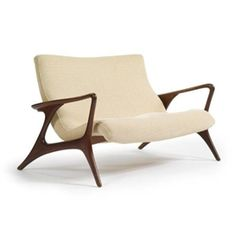 "Artwork by Vladimir Kagan, ""Contour"" Loveseat, Made of walnut and fabric upholstery"