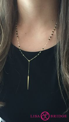 Your statement jewelry can be real and affordable. Complete your look with this black spinel necklace in 14K yellow gold!