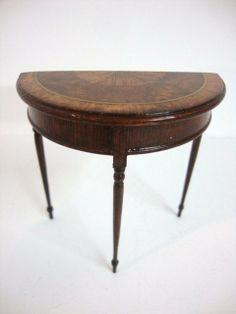 """Elegant little demilune table 2.5"""" H and W with three very delicate legs and a top inlaid with burled walnut and cross banding, signed by Dennis Jenvey 1989."""
