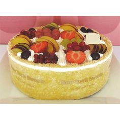 New Fruit Cake Delivery Cyprus - A rich, moist orange sponge topped with an explosion of fresh seasonal fruits and fresh cream, made daily to order.