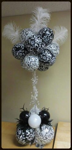 Spiral Spirit Balloon Company •  Balloon topiary--black and white damask balloons and white ostrich feathers