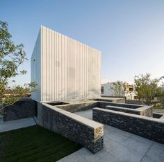Neri & Hu's Suzhou Chapel combines textured brick base with ethereal white cube