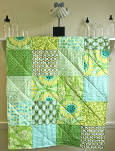 Crib Quilt -  Pop Daisy - Gender Neutral Baby Blanket in Green, Yellow, and Aqua fabrics by Heather Bailey. $98.00, via Etsy.