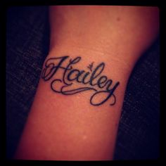 Daughters name tattoo on left wrist