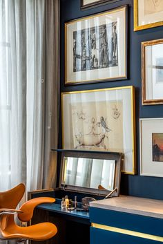 Orange and blue bedroom with grouped artwork - The Rovers Return Luxury interior designs by Daniel Hopwood and Studio Hopwood. Designs featuring on the Martyn White Designs Blog