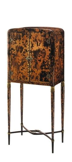 Frans Franck and Frans Bruylants A RARE RADIO CABINET produced and retailed by Maison Franck, Antwerp numbered in chalk 27254 and m6848 vermillion-backed tortoiseshell, patinated bronze, painted and parcel gilt wood 51 1/4 x 21 1/2 x 13 1/2 in. (130.3 x 54.6 x 34.3 cm) ca. 1924