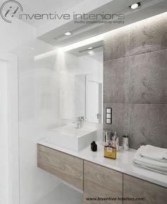 Projekt mieszkania Inventive Interiors - białe płytki,  beton i jasne drewno w łazience