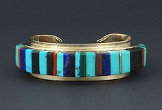 Charles Loloma | 14K cuff bracelet with inlay of turquoise, lapis lazuli, coral, malachite and ironwood | (Hopi)