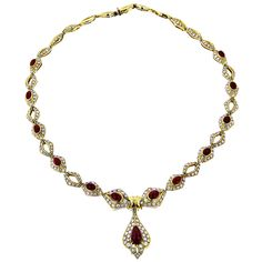 Designer necklace in 18 K yellow gold set with diamonds and oval and pear cut rubies. All of our hand crafted necklaces are available in 9K/14K/18K white, yellow and rose gold, platinum and palladium and can be set with a variety of precious stones. Product No: ZN11006