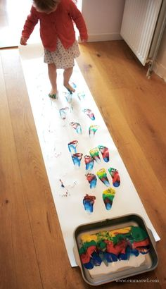 Rainbow walking- what a fun way to paint with children!