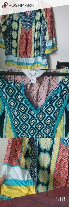 Crown & Ivy Tunic This Flowy Tunic has beautiful patterns and is perfectly lightweight for Summer! 100 % Rayon. Theres a small tear where the tag is but in excellent condition otherwise! Size is labeled as a women's petite. It will fit a small or medium. Crown & Ivy Tops Tunics