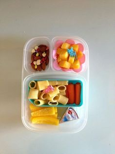 Yellow peppers, Laughing Cow cheese, carrots, pasta with Parmesan cheese, mango, homemade trail mix with almonds, white chocolate chips and Trader Joe's chocolate covered sunflower seed drops. #foodforharper #bento #easylunchboxes