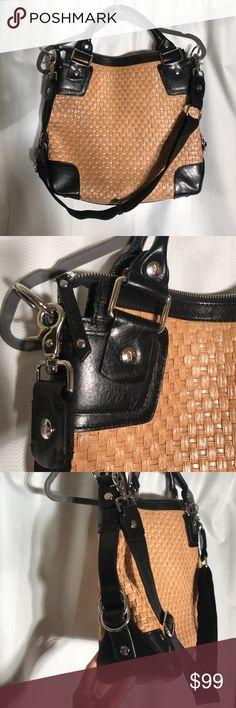 Donald J Pliner black leather and weave purse. Donald J Pliner black leather and weave purse.  Stunning bag. Has removable shoulder strap. 13Hx 14L x 4.5 W. Worn once, perfect condition. Great summer bag Donald J. Pliner Bags
