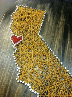 California state string art sf gold and red bay area love 9x12 painted wall art distressed black golden state. $18.99, via Etsy.